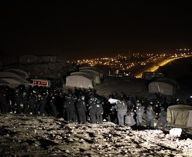 The eviction took place at night, but it was still caught on both photo and film.   JPost, January 13, 2013.