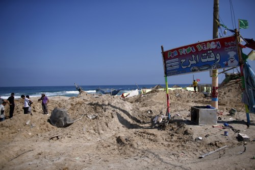 Palestinians search for bodies in the southern Gaza Strip on July 10, 2014 at a beach cafe hit the previous night by an Israeli air strike while people were watching the World Cup (AFP/Thomas Coex)